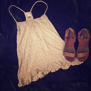 Adorable and flirty strappy top!